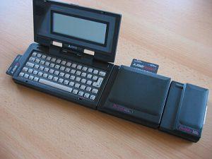 Atari Portfolio mit Memory-Expander, Parallel-Interface und Speicherkarten